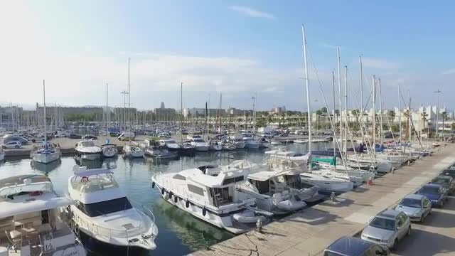 Wide Angle Shot Of Port Olympic: Stock Video