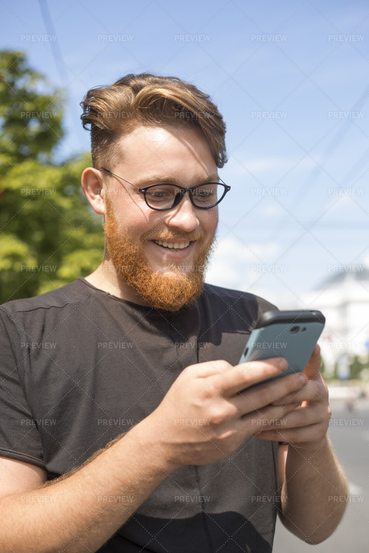 Guy Uses A Mobile Phone.: Stock Photos
