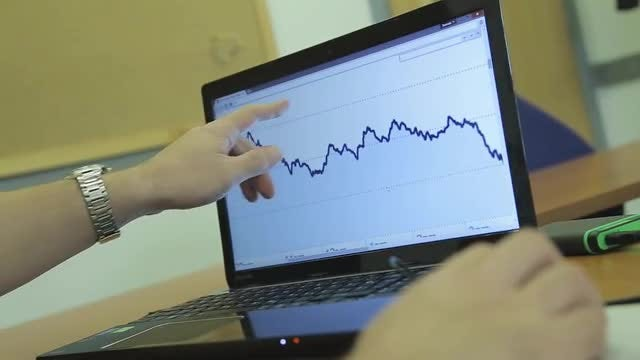 Businessman Watching Online Market Trends: Stock Video