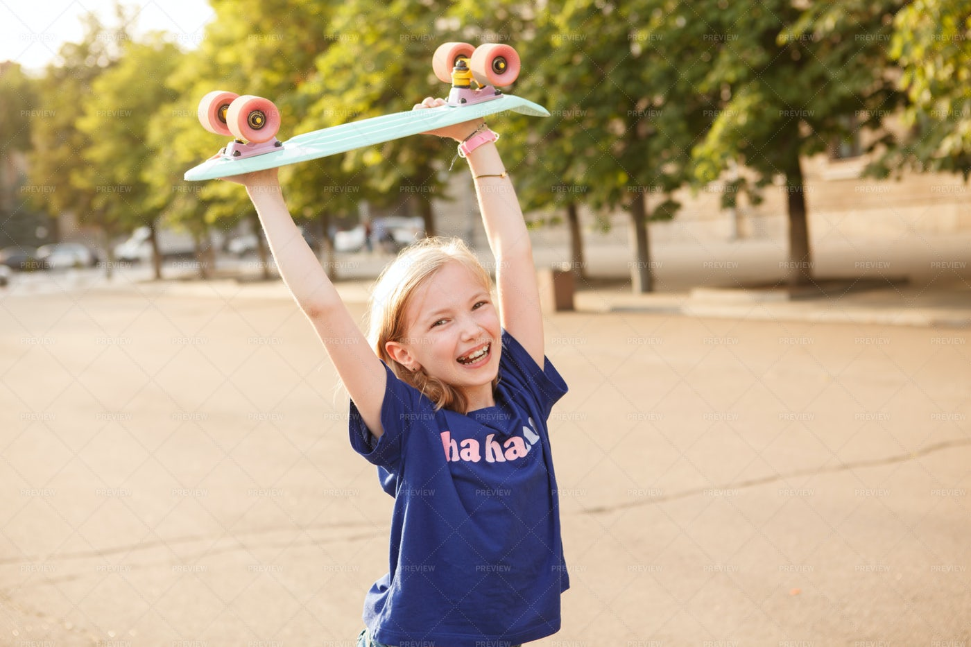 Girl With Pennyboard Outdoors: Stock Photos