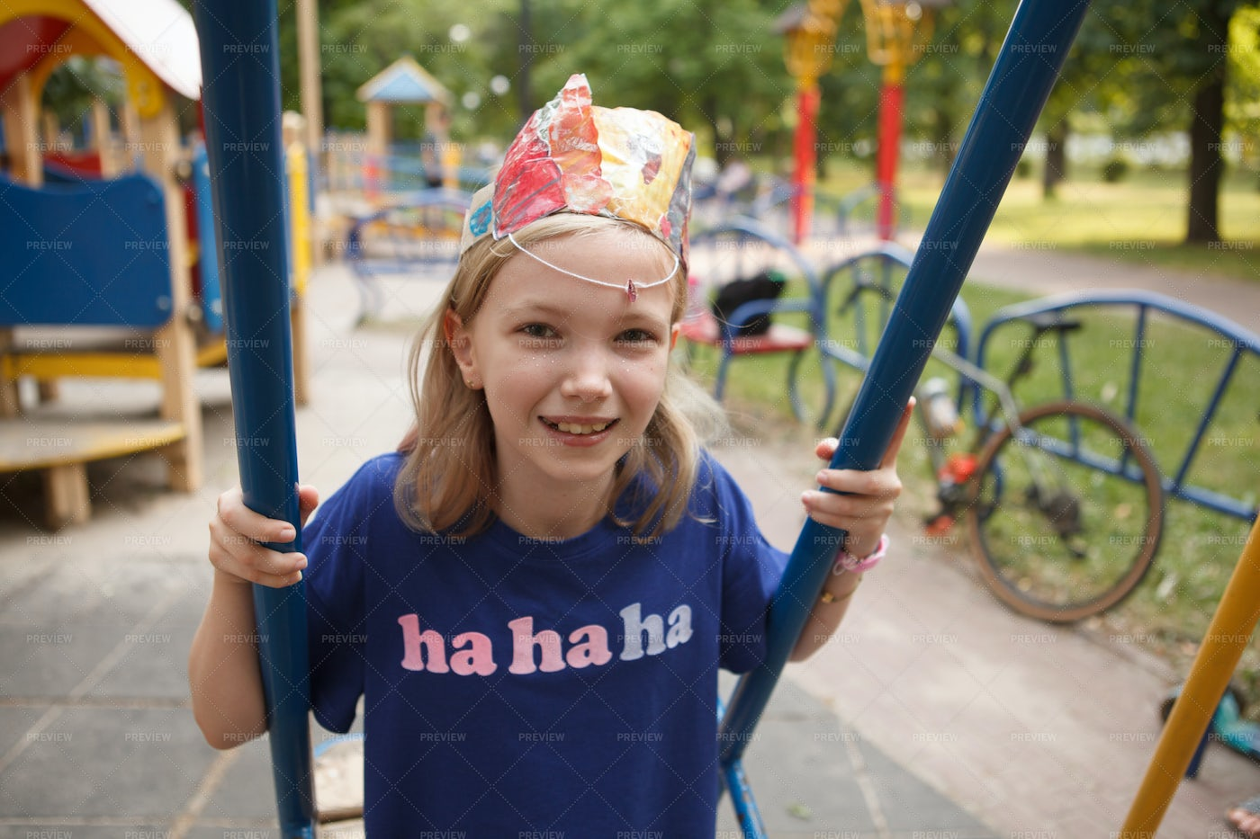 Girl On A Swing On Playground: Stock Photos