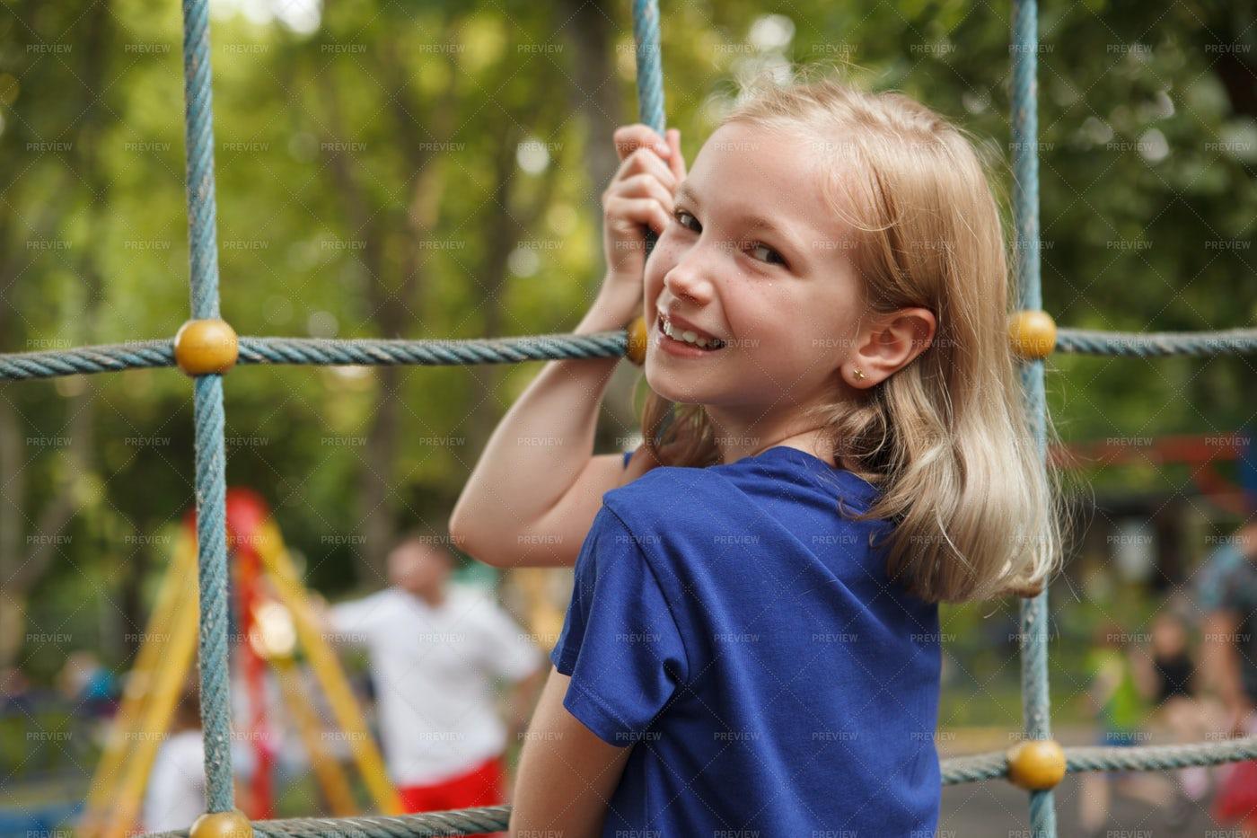 Girl Climbing On Playground: Stock Photos