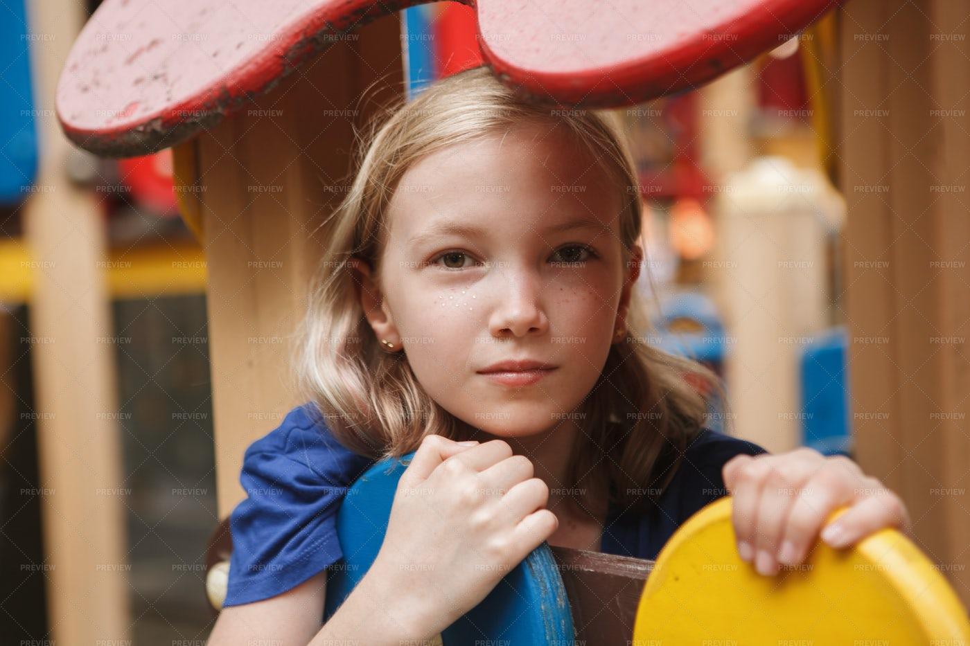 Sad Kid On Playground: Stock Photos
