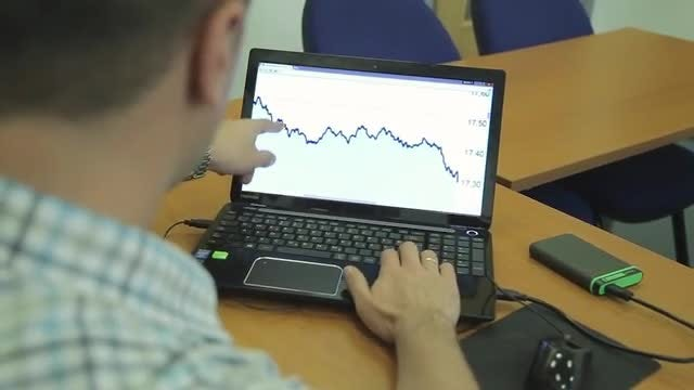 Man On Laptop Explains Data: Stock Video