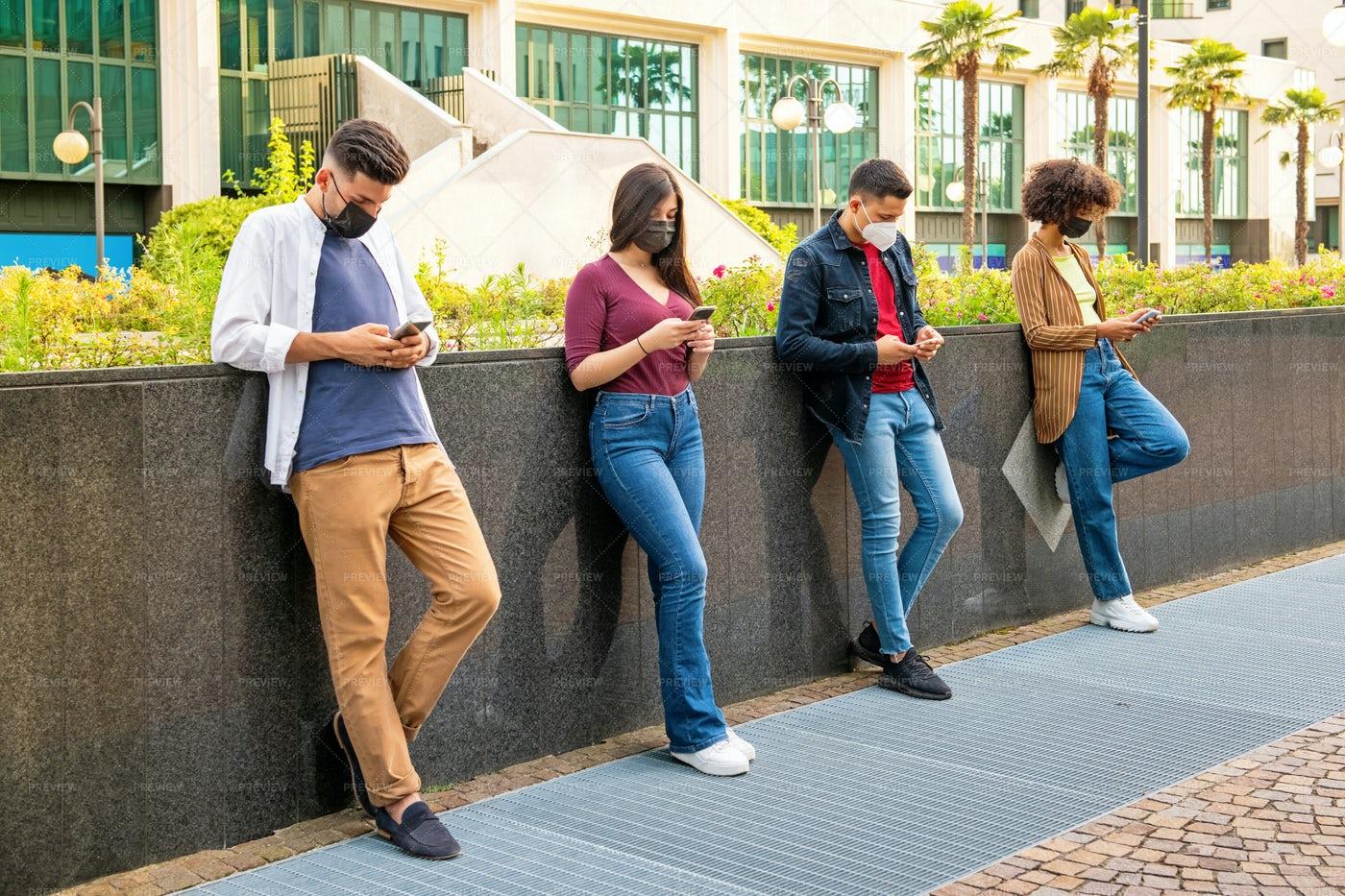Texting And Social Distancing: Stock Photos