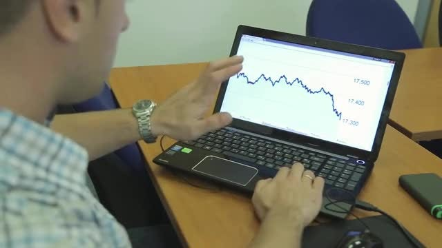 Man Presents Graph On Computer: Stock Video