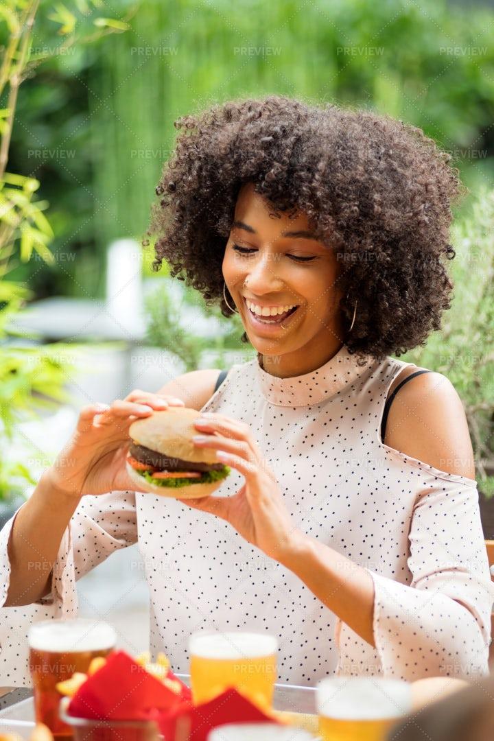 Woman Eating Hamburger: Stock Photos