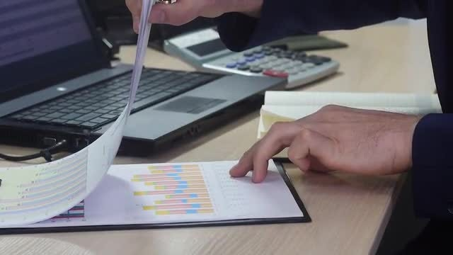Businessman Working With Business Charts: Stock Video