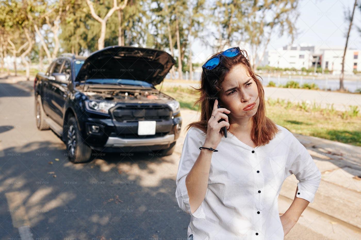 Stressed Woman Calling Mechanic: Stock Photos