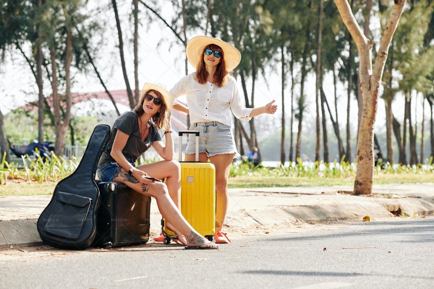 Hitchhikers Catching Car: Stock Photos