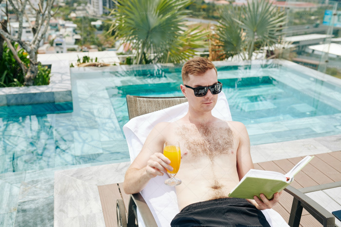 Man Reading By Pool: Stock Photos