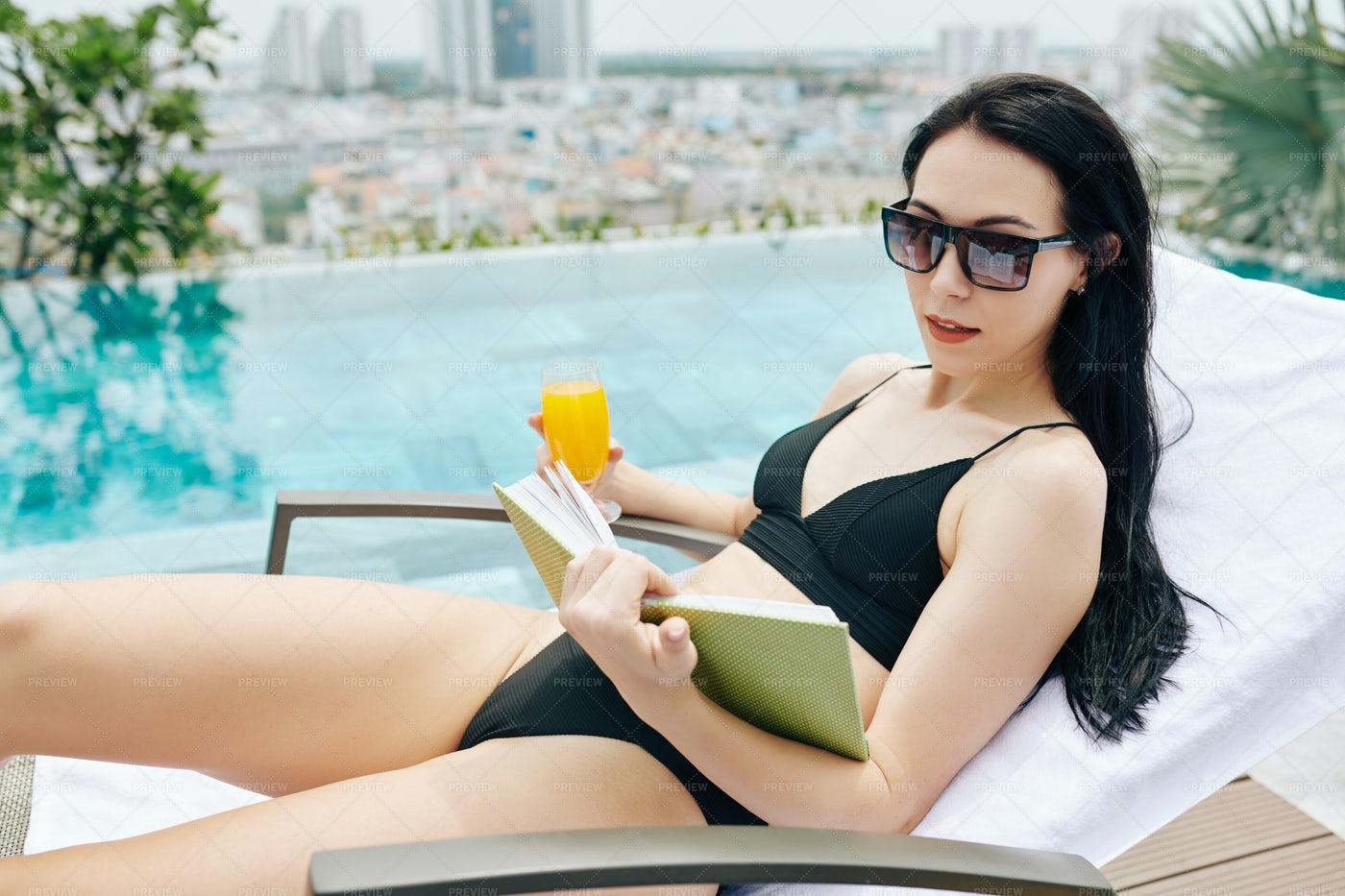 Young Woman Reading Novel: Stock Photos