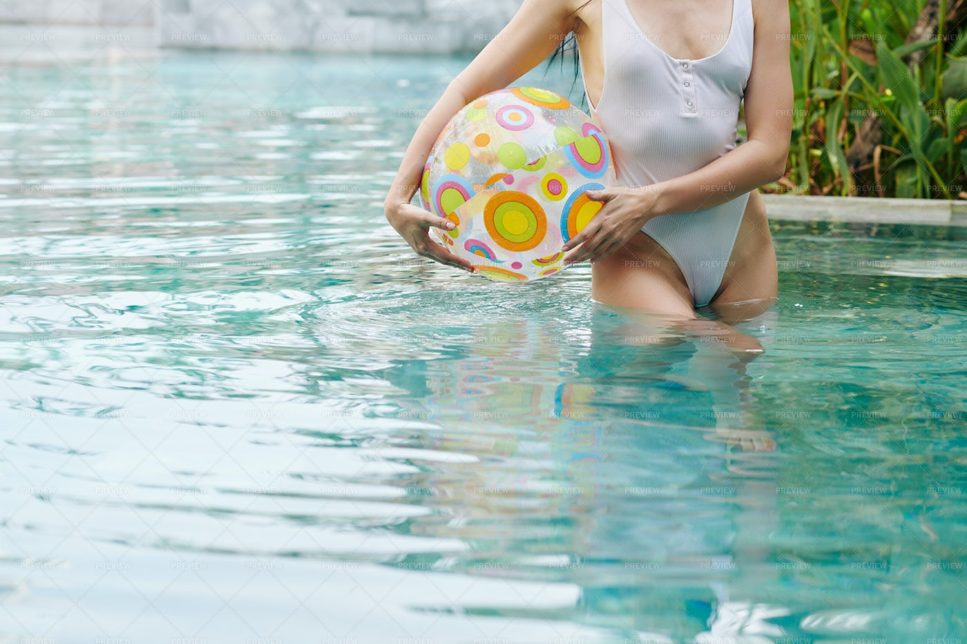 Woman Standing In Pool With Inflatable B: Stock Photos
