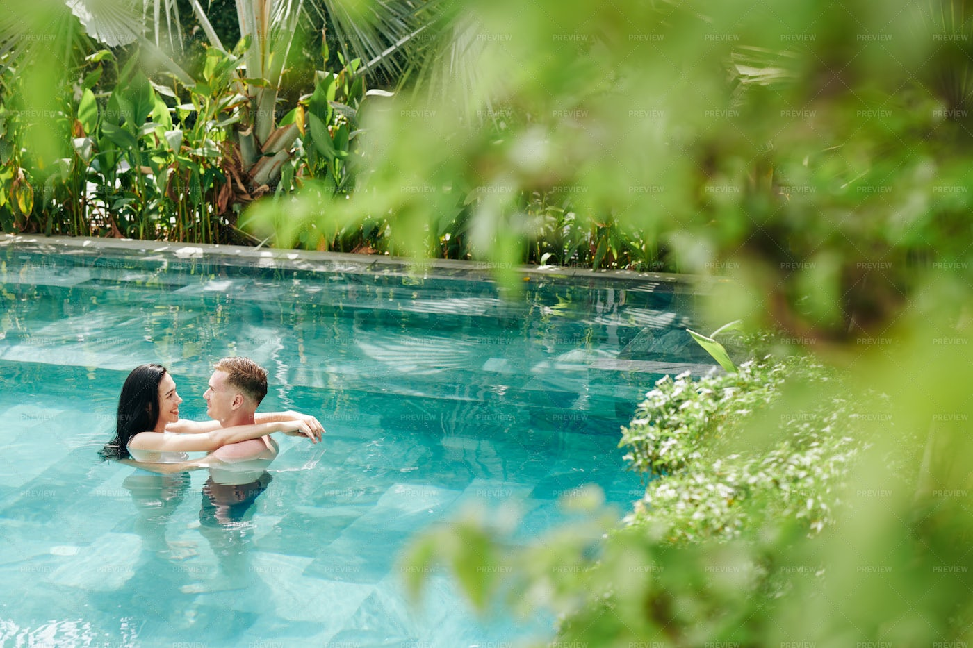 Couple In Swimming Pool: Stock Photos