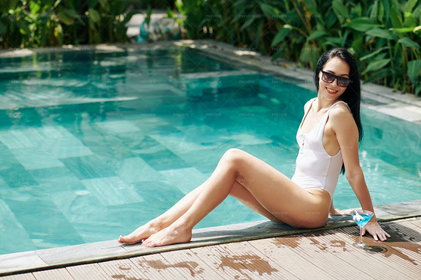 Woman Resting By Pool: Stock Photos