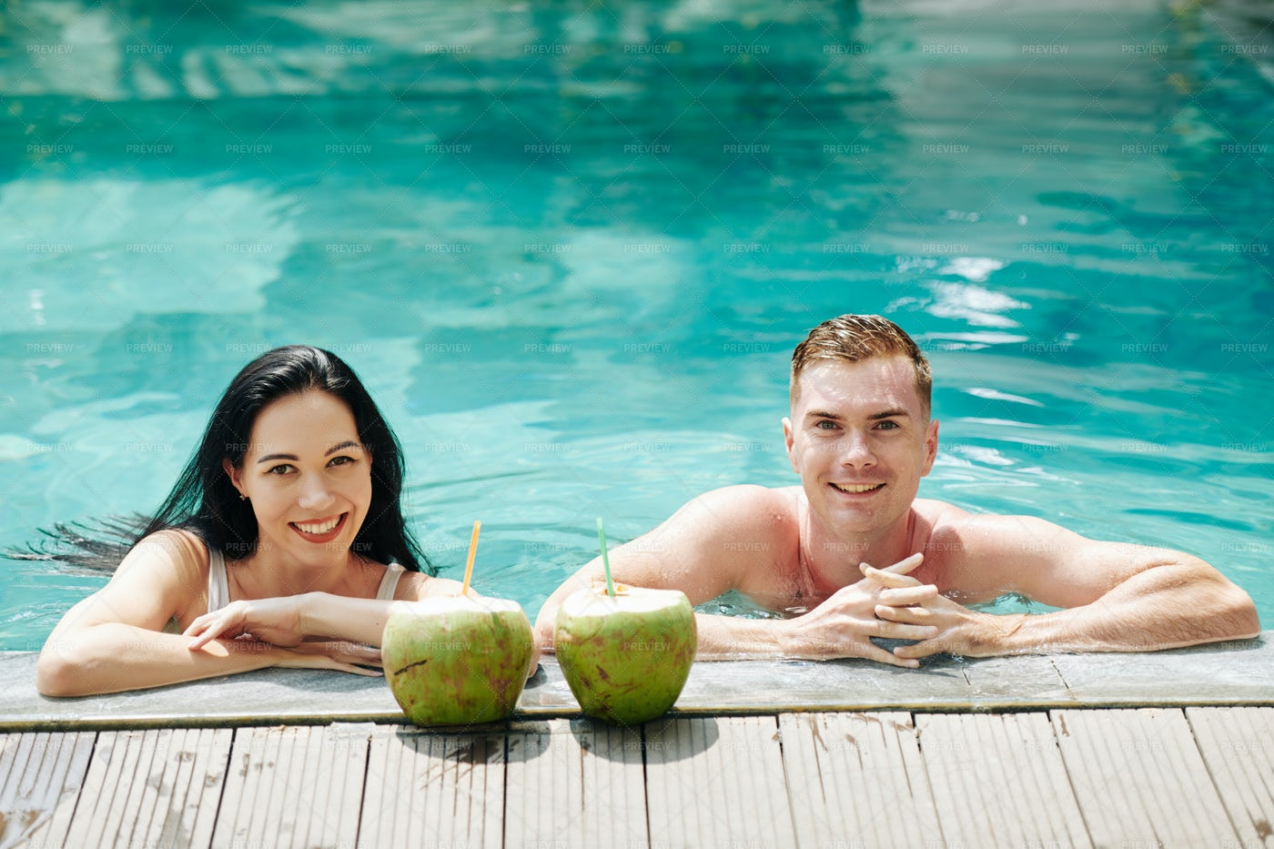 Smiling Couple In Swimming Pool: Stock Photos