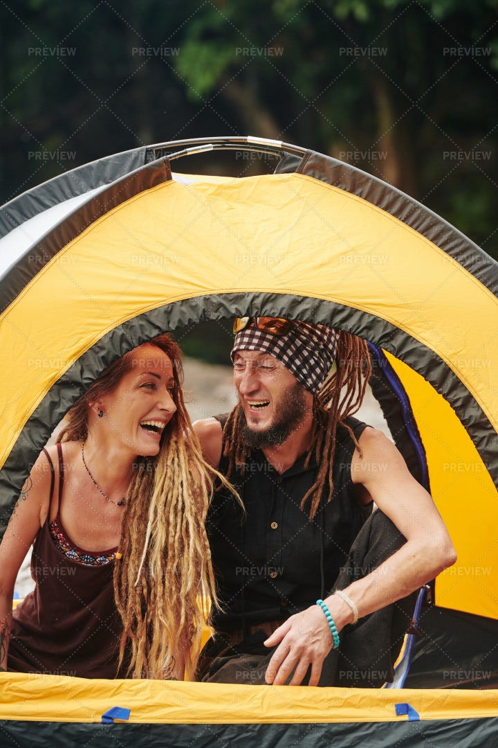 Happy Couple Sitting In Tent: Stock Photos