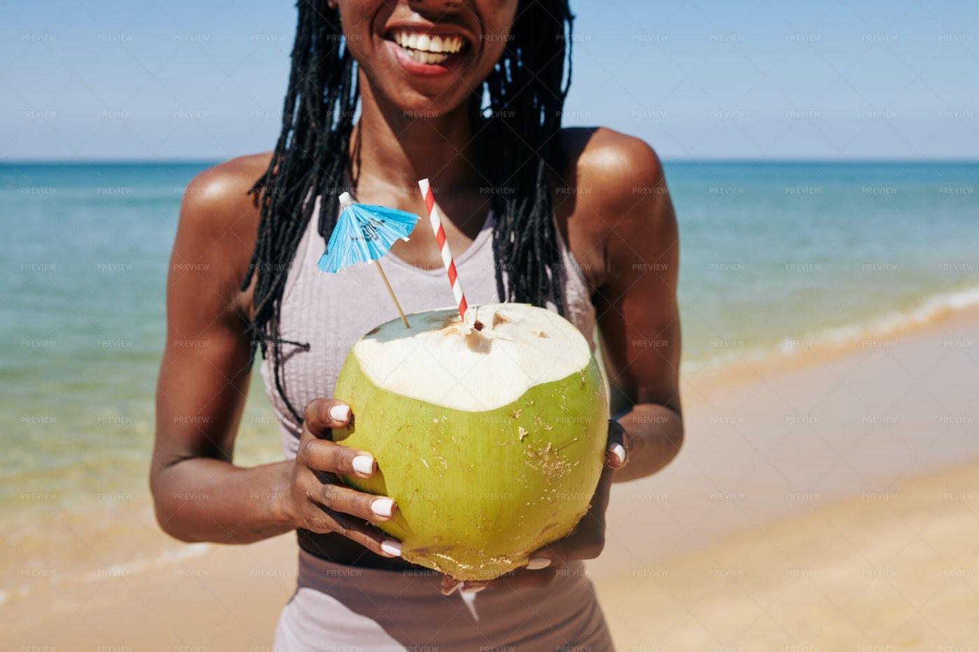 Woman Enjoying Coconut Cocktail: Stock Photos