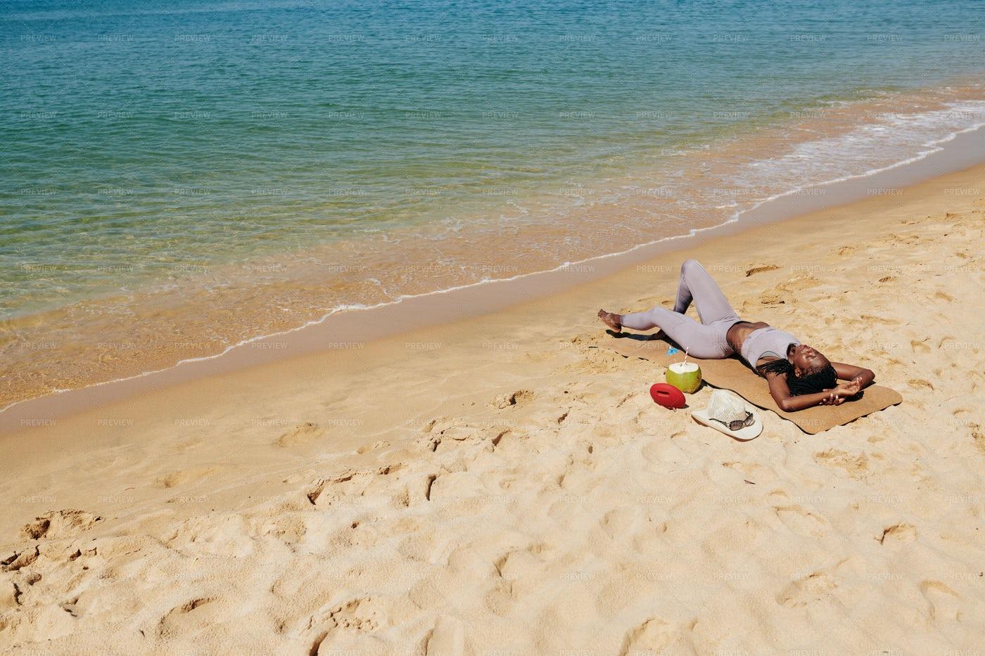 Woman Relaxing On Beach: Stock Photos
