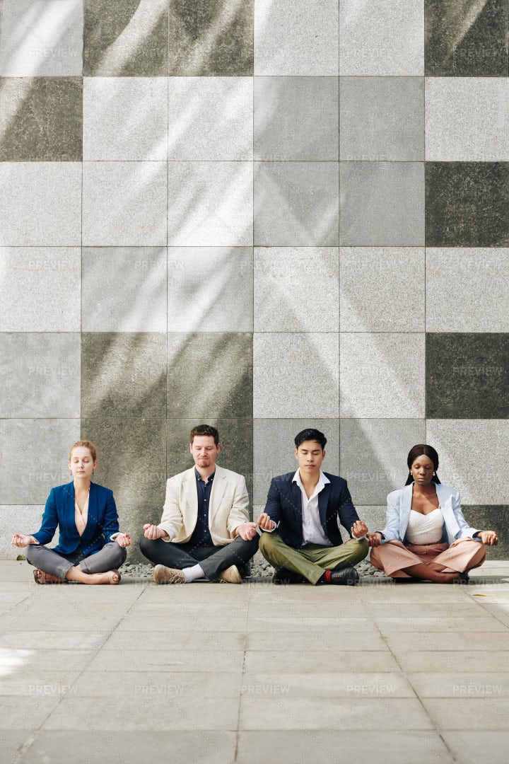 Business Team Practicing Meditation: Stock Photos