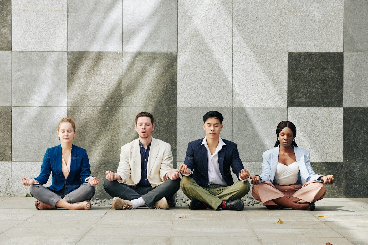 Business People Meditating Together: Stock Photos