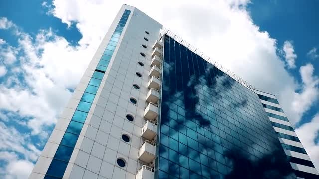 Skyscraper Among Clouds: Stock Video