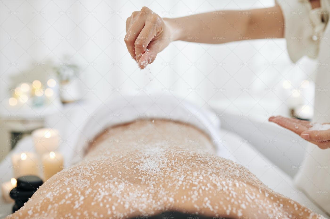 Beautician Applying Salt Scrub: Stock Photos