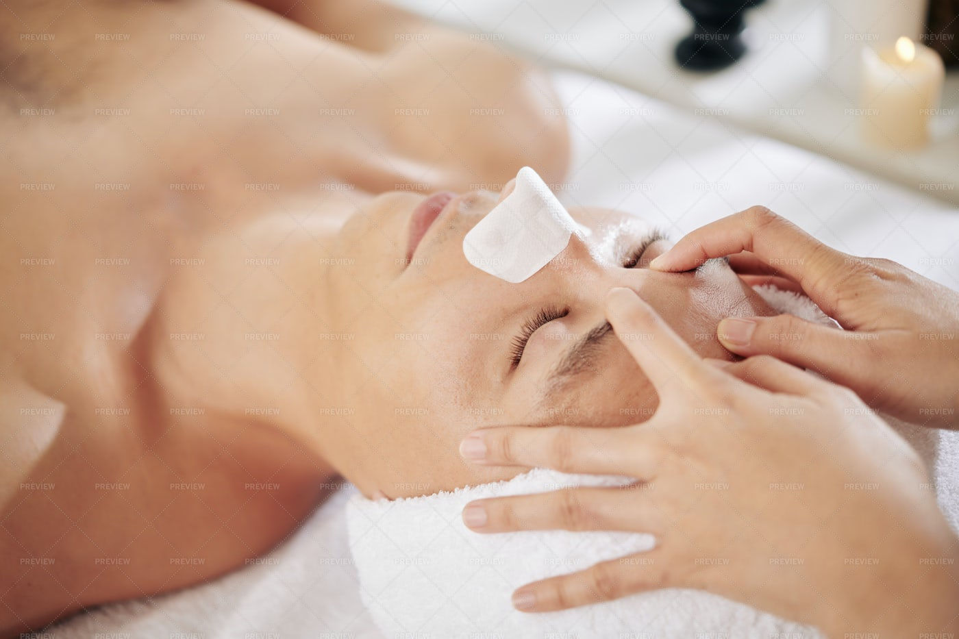 Rejuvenating Face Massage For Man: Stock Photos