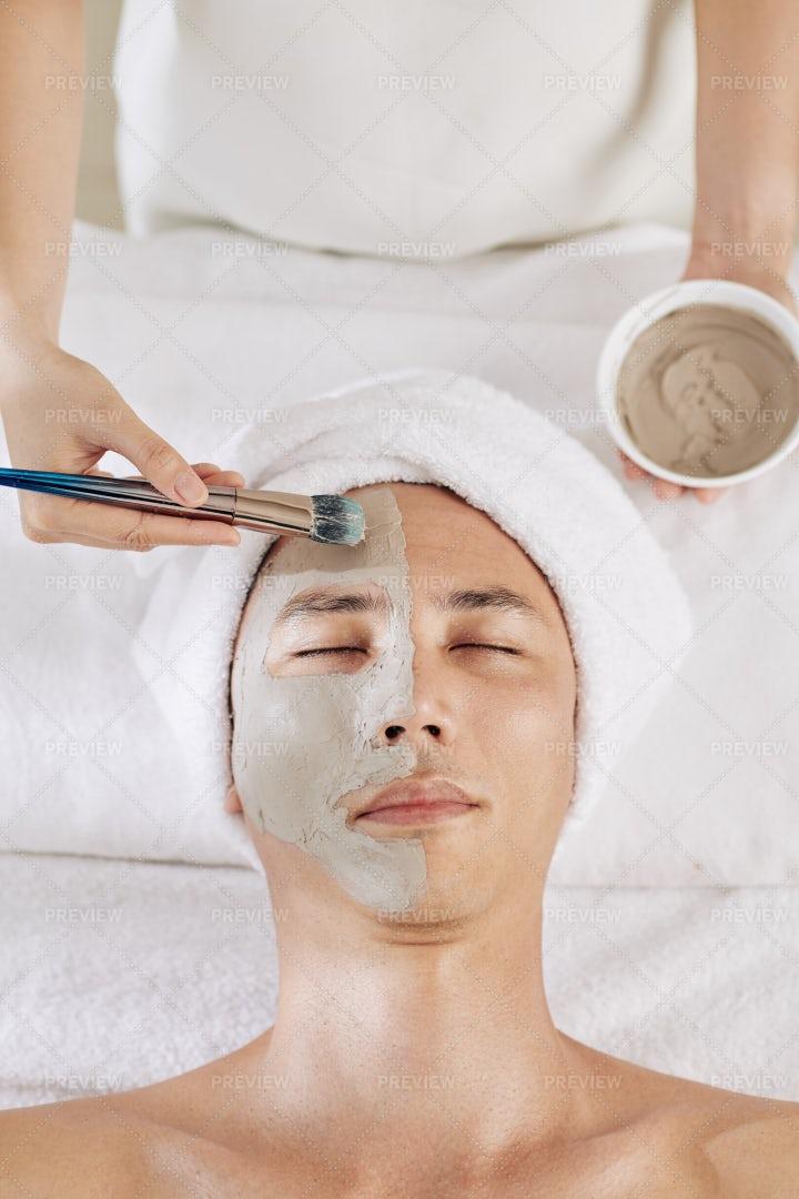 Beautician Applying Clay Mask: Stock Photos