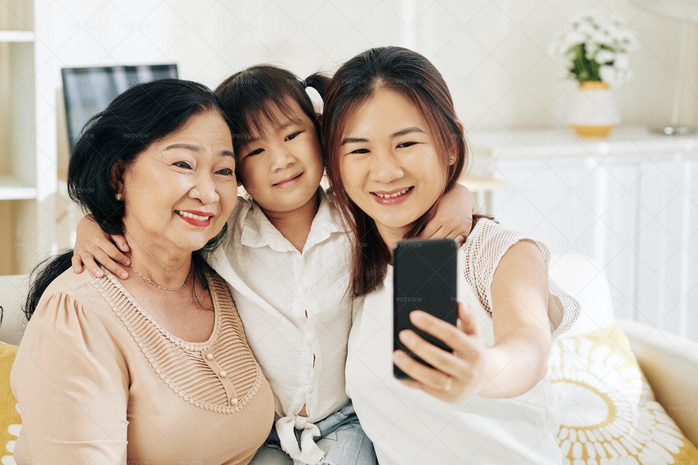 Hugging Family Taking Selfie: Stock Photos