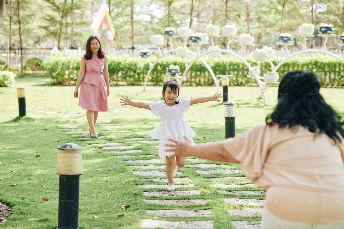 Girl Running To Grandmother: Stock Photos