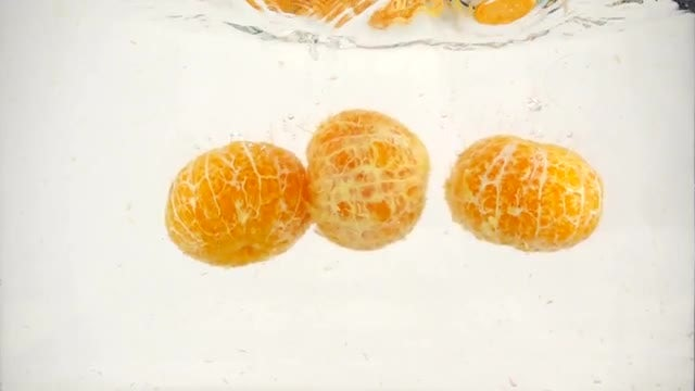Mandarin Oranges Falling Into Water : Stock Video