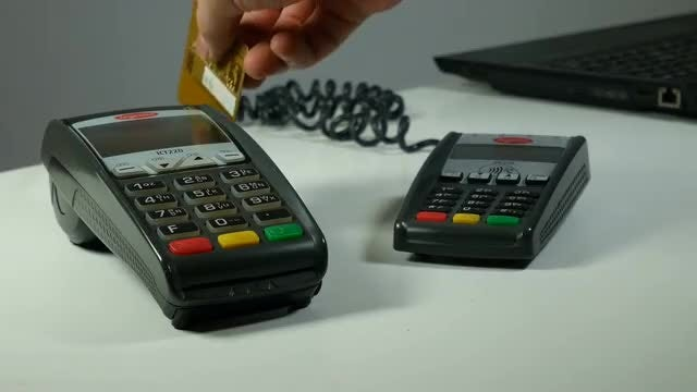 Swiping A Debit Card: Stock Video