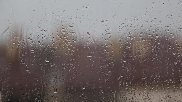 Raindrops On Window Glass: Stock Video