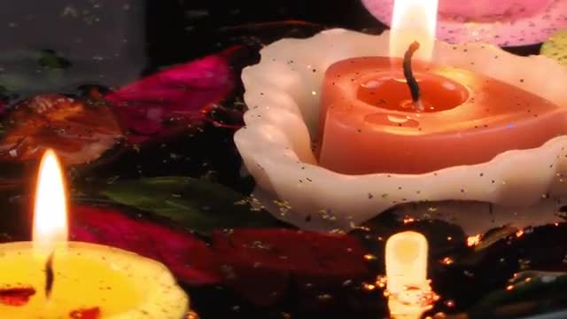 Candles With Dry Petals Floating : Stock Video