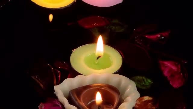 Candles , Dry Leaves On Water: Stock Video