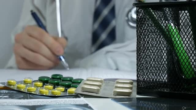 Doctor Logs Medicine Prescriptions : Stock Video
