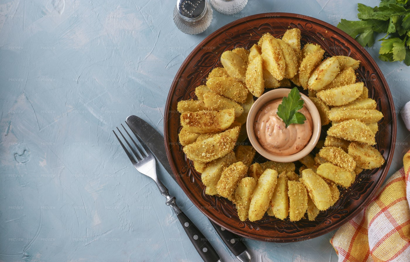 Baked Potatoes On A Round Plate: Stock Photos