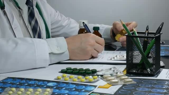 Doctor Looking Through Medicines: Stock Video