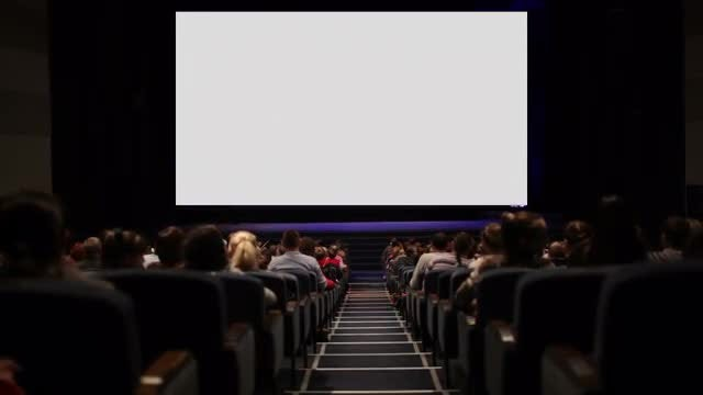 Cinema Audience Watching White Screen: Stock Video