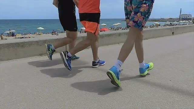Runners On The Coastline Slow Motion: Stock Video
