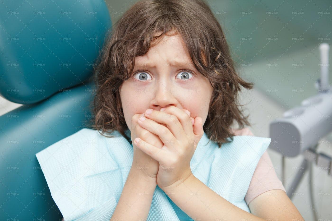 Terrified Boy At Dental Clinic: Stock Photos