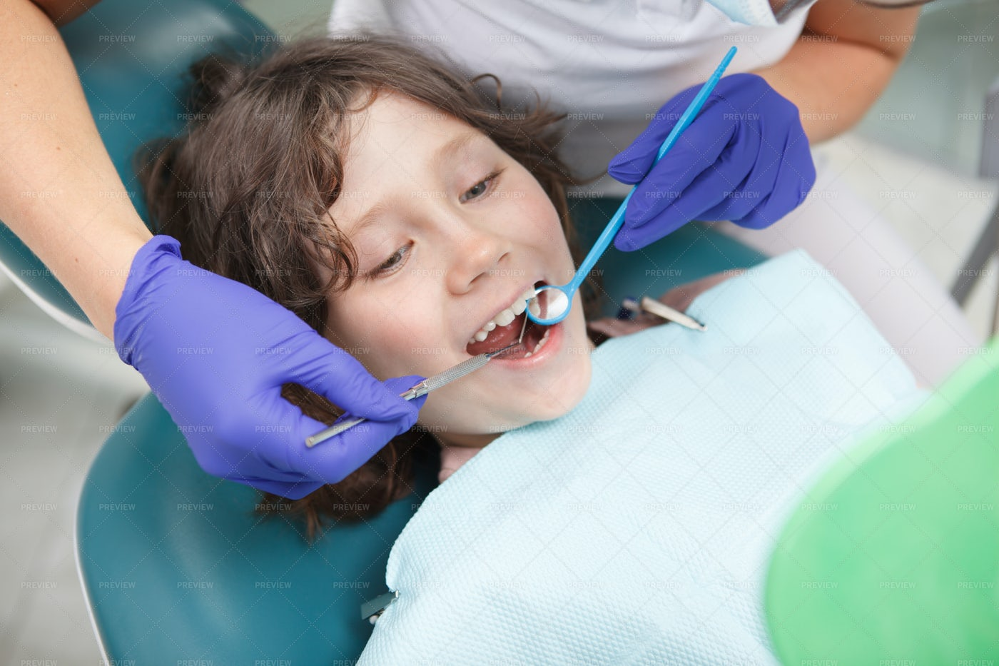 Dentist Checking Teeth Of A Boy: Stock Photos