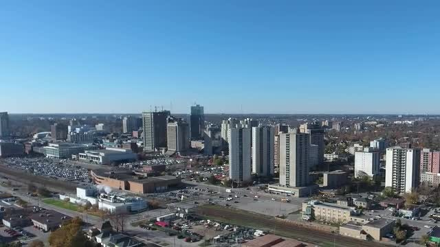 Cityscape with Buildings & Traffic Aerial: Stock Video