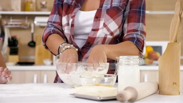 Mom Showing Daughter How To Knead Dough: Stock Video