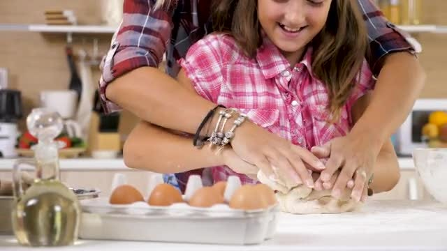 Daughter Kneading Dough: Stock Video