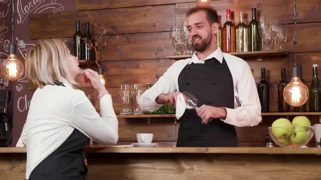 A Bartender Listens: Stock Video