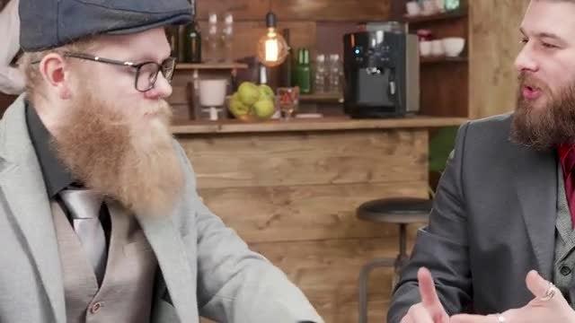 Men Talk In A Cafe: Stock Video