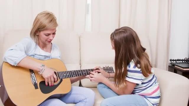 Teach Mom To Play Guitar: Stock Video