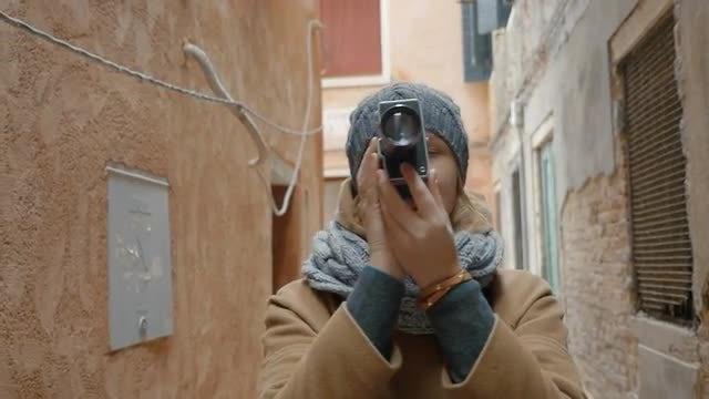 Female Using Retro Camera: Stock Video
